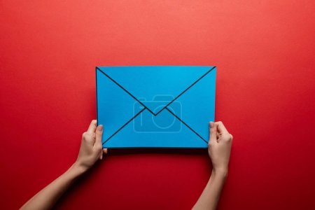 Photo for Top view of blue mail sign on red background - Royalty Free Image