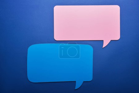 empty pink and blue speech bubbles on blue background