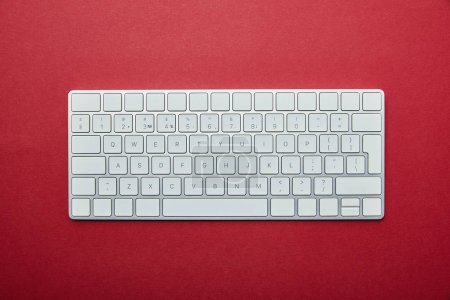 Photo for Top view of computer keyboard on red background - Royalty Free Image