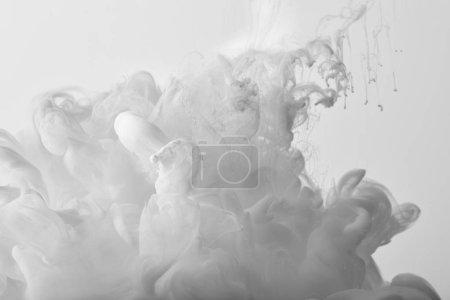 white swirls of paint on white background