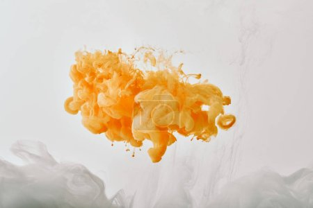 artistic background with white and orange splash of paint