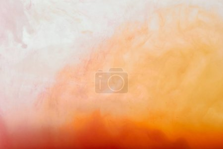 abstract texture with white and orange swirls of paint