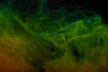 abstract background with green and orange swirls of paint