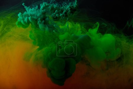 abstract background with green and orange splashes of paint
