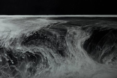 abstract flowing swirls of grey paint in water