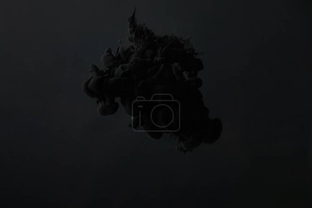 black watercolor paint splash on dark background