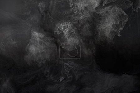 texture monochrome abstraite avec tourbillons de peinture gris