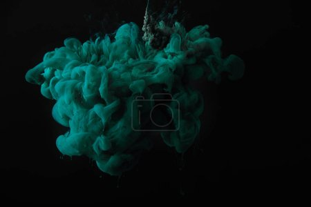 Photo for Abstract dark wallpaper with green splash of paint - Royalty Free Image