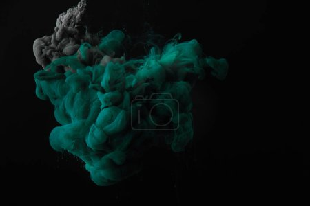 abstract dark background with green and grey splashes of ink
