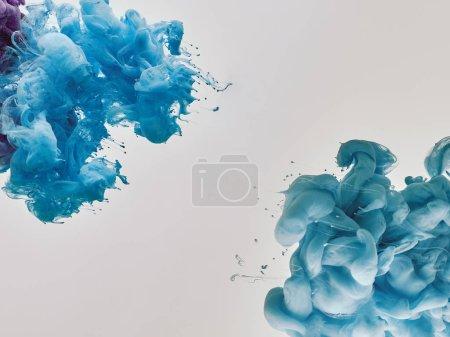 blue splashes of paint on white background