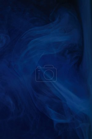 Photo for Abstract dark texture with blue swirls of paint - Royalty Free Image