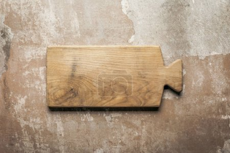 wooden board on rustic background with copy space