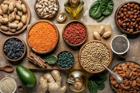 Photo for Flat lay of legumes, superfoods and healthy ingredients on wooden board with rustic background - Royalty Free Image