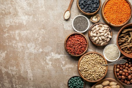 Photo for Top view of superfoods, legumes and healthy ingredients on rustic background with copy space - Royalty Free Image