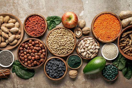 Photo for Top view of superfoods, legumes and healthy ingredients on rustic background - Royalty Free Image