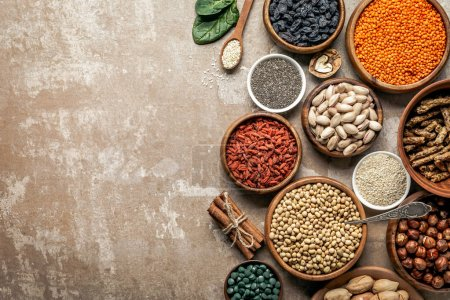 top view of superfoods, legumes and healthy ingredients on rustic background with copy space