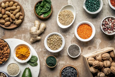 Photo for Flat lay of superfoods, spices and legumes on textured rustic background - Royalty Free Image