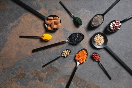 Photo for Flat lay of spoons with superfoods, legumes and grains on table - Royalty Free Image