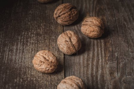 Photo for Close up view of tasty walnuts on wooden surface - Royalty Free Image