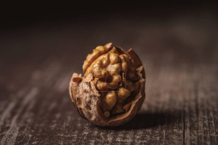 Photo for Close up view of shelled walnut on wooden tabletop - Royalty Free Image