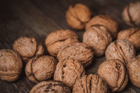 Photo for Close up view of walnuts on wooden tabletop - Royalty Free Image