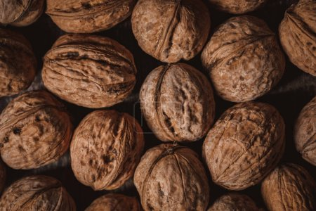 Photo for Full frame of walnuts arranged as backdrop - Royalty Free Image