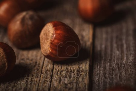 Photo for Close up view of shelled hazelnuts on wooden tabletop - Royalty Free Image