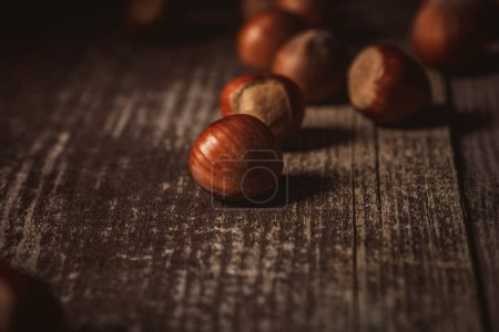 close up view of shelled hazelnuts on wooden tabletop