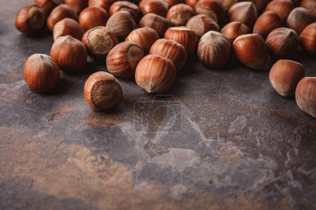 Photo for Close up view of shelled hazelnuts on grey tabletop - Royalty Free Image