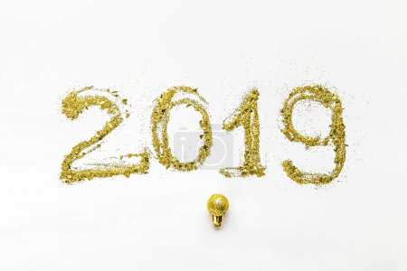 Photo for Golden glittering 2019 symbol and shiny christmas ball on white background - Royalty Free Image