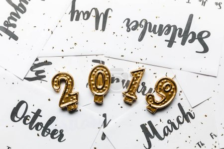 close-up view of golden 2019 candles and calendar