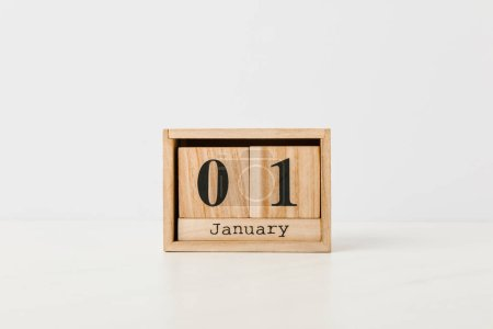 close-up view of wooden calendar with 01 january on white background