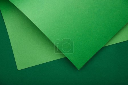 view from above of green paper on colored background