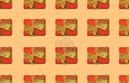 Photo for Seamless background with christmas presents with golden bows - Royalty Free Image