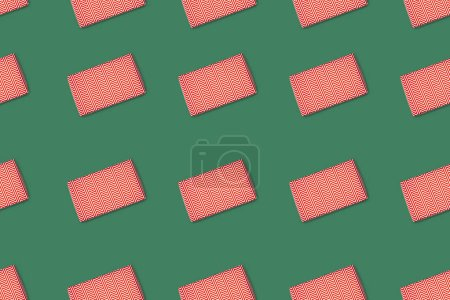 Photo for Top view of red wrapped gifts isolated on green background - Royalty Free Image