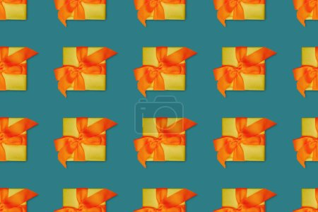 Top view of seamless christmas background with gift boxes with orange bows
