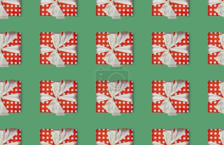 christmas seamless background with gift boxes with polka dots and bows