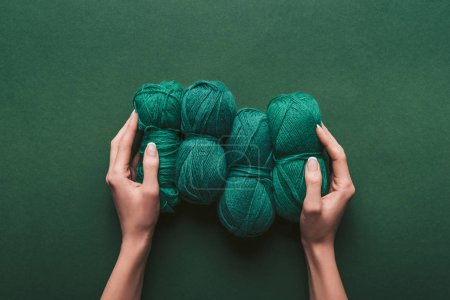 Photo for Cropped shot of woman holding yarn on green backdrop - Royalty Free Image