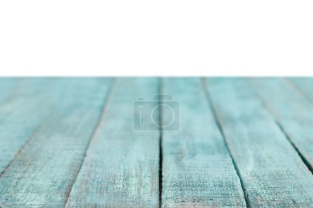 selective focus of turquoise striped wooden background on white