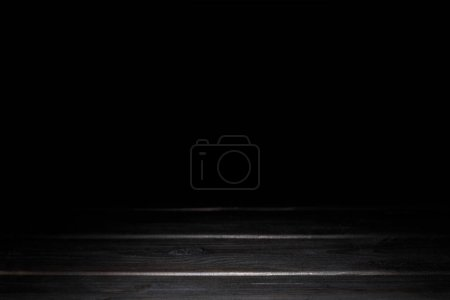 dark grey wooden background with stripes on black