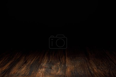 Photo for Dark brown striped wooden background on black - Royalty Free Image