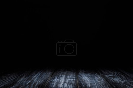 Photo for Dark grey grungy wooden background on black - Royalty Free Image
