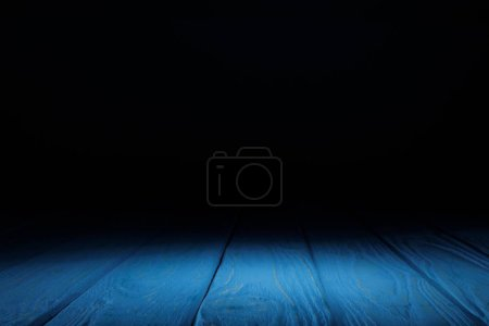 Photo for Blue striped wooden tabletop on black - Royalty Free Image