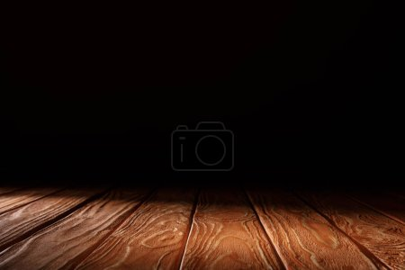Photo for Orange striped wooden textured background on black - Royalty Free Image
