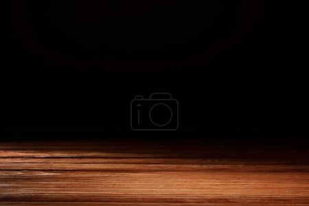 Photo for Orange striped wooden material on black - Royalty Free Image