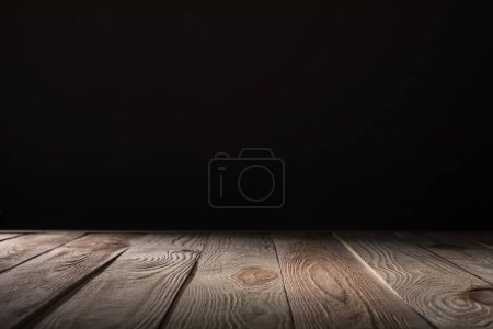 Photo for Brown striped wooden background on black - Royalty Free Image