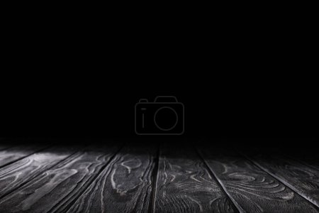 Photo for Dark grey striped wooden material on black - Royalty Free Image