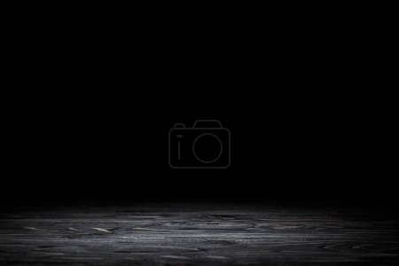 Photo for Dark grey striped wooden tabletop on black - Royalty Free Image