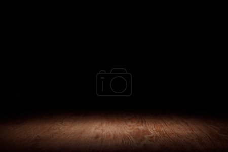 Photo for Brown striped wooden tabletop on black - Royalty Free Image