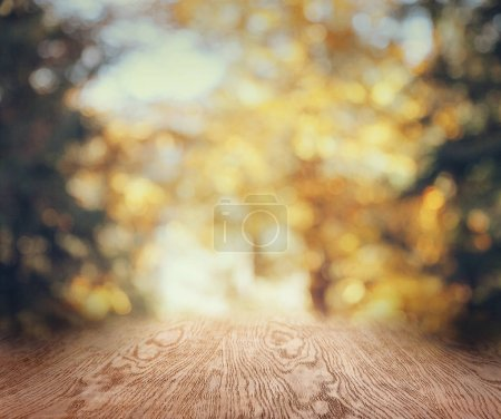 Photo for Striped wooden background on beautiful blurred autumnal wallpaper - Royalty Free Image